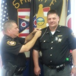 Deputy John Thorman was promoted to Jail Sergeant on 9/23/2014. Seen is Sheriff Lucas pinning on his Sergeant bars.